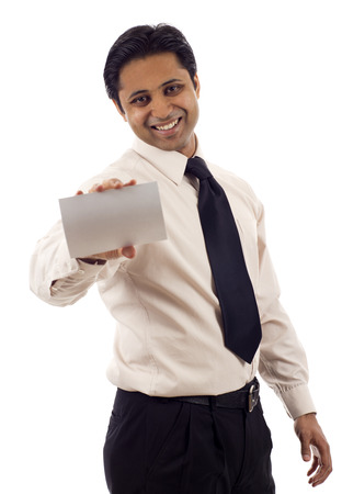 Happy Indian businessman presenting a blank card isolated over white background 写真素材
