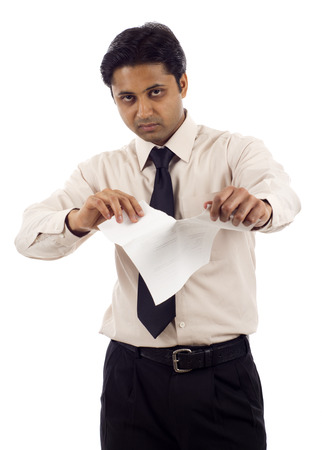 broken contract: Angry Indian businessman  tears up a contract isolated over white background