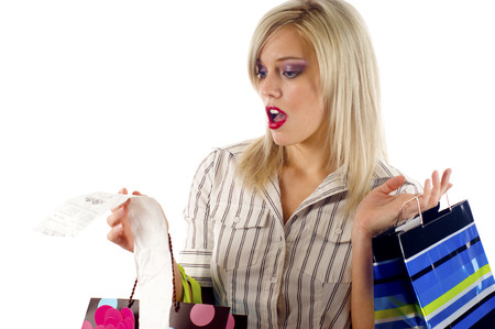 shoppingbags: Blond woman was shocked after looking at her receipt Stock Photo