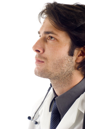 deep thought: Closeup of young medical doctor in deep thought, Isolated over a white background
