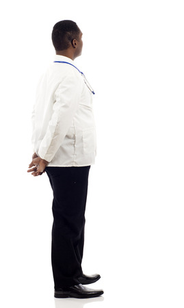 black hand: African American doctor from the back - looking at something over a white background