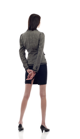 Mujer de negocios de la parte posterior - mirando algo sobre un fondo blanco Foto de archivo - 41403596