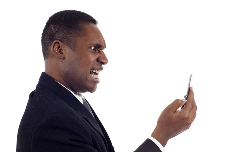yells: Angry African American business man screaming on the phone isolated white background