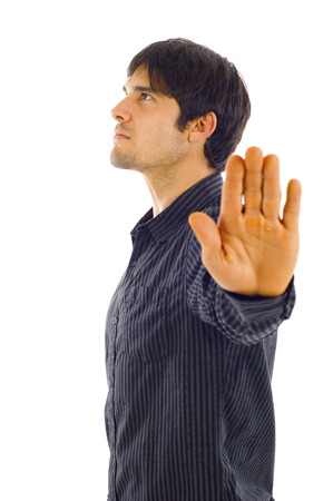 Young & Confident Business Man Showing Stop Hand Sign -Isolated on white background photo