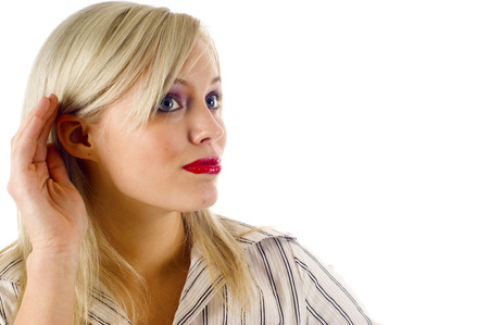 raises: Business Woman Raises her Hand to her Ear to Liisten Stock Photo