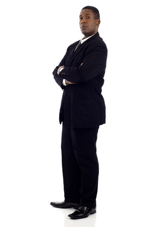 Side view of a confident African American businessman standing with his hands crossed isolated white backgroun Stock Photo