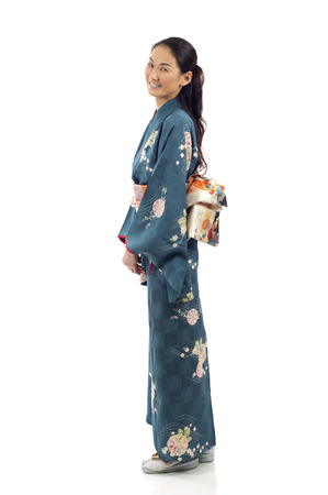 Side view of a pretty smiling Japanese kimono woman standing isolated over white background Stok Fotoğraf