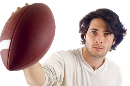 Young handsome man holding a football isolated over white Stock Photo