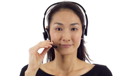 handsfree phones: Female customer service operator isolated over white background