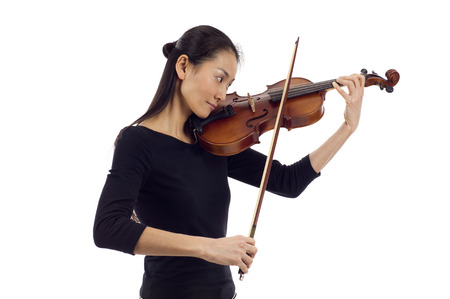 chinese american ethnicity: Asian woman playing the violin isolated over white background