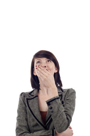 astounded: Surprised young lady looking up at copyspace isolated white background