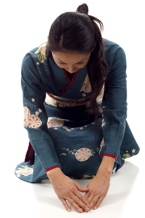 foreign bodies: Japanese kimono woman bowing isolated over white background Stock Photo