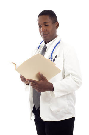 African-american doctor holding and reviewing a medical chart isolated on white background