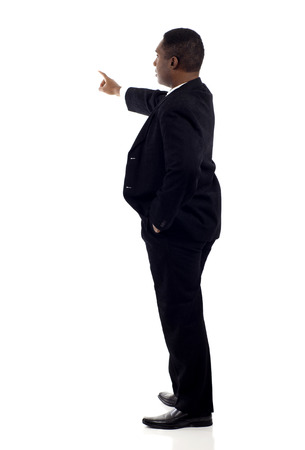 entrepreneurial: Confident Black businessman points up,presenting over white background