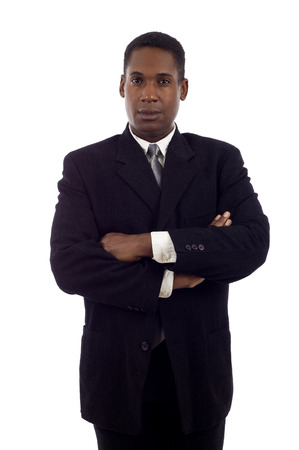 Serious looking African American business man standing with hands folded isolated white background Фото со стока