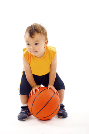 running nose: Baby Boy with a Running Nose, Playing with a Basketball- Isolated over a white background Stock Photo