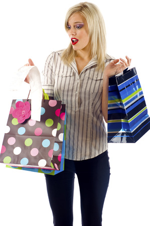 overspending: Woman Shopping- Overspending - Isolated over a White Background Stock Photo
