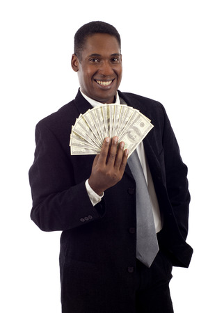 man holding money: African American man holding lots of money smiling isolated white background Stock Photo