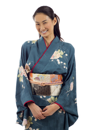 informal clothes: Smiling Japanese woman in traditional clothes of Kimono full length portrait isolated over white background