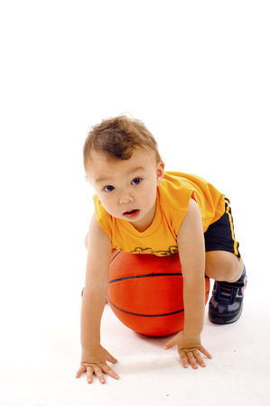 Adorable Baby Boy Playing with a Basketball a lot of Copyspace - Isolated over a White Background