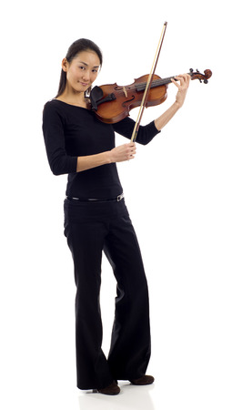 chinese american ethnicity: Full length of an Asian woman playing the violin isolated over white background