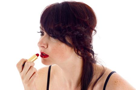 메이크업 - 아름다운 여자가 립스틱을 적용