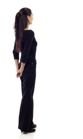 Asian business woman from the back - looking at something isolated over white background 版權商用圖片