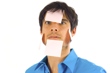 Business Man with Post it Note all over his Face