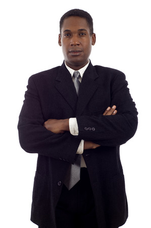 Confident good looking African American business man standing with hands folded isolated white background Фото со стока
