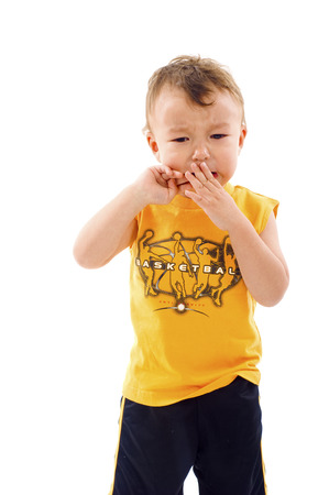 fussy: Baby Boy has finally Stopped Crying, and Started to bite his Fingernails - Isolated over a white background