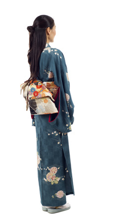 Japanese kimono woman from the back looking at something isolated over white background Stok Fotoğraf