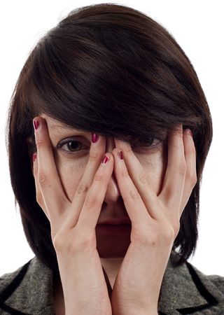 ugly people: Closeup of a sad woman covering up her face with her hands