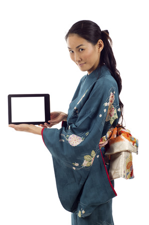 Japanese kimono woman holding a tablet pc isolated over white background