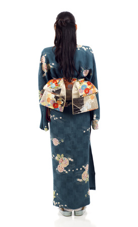 foreign bodies: Full length back view of a Japanese kimono woman standing isolated over white background