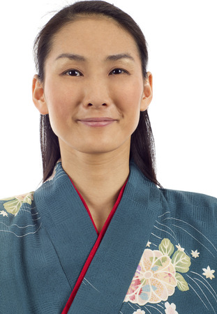 Closeup portrait of Japanese kimono woman isolated over white background Stock Photo