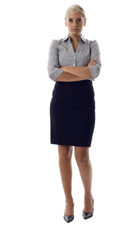 Confident and determined business woman standing with folded hands isolated over a white background photo