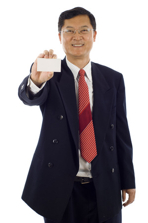 Isolated portrait of a senior Asian business man holding a blank business, the focus was on teh business card.