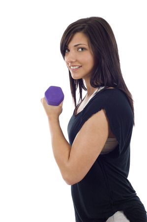 Young woman exercising with dumbbell isolated over white
