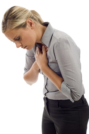 Woman with chest pain isolated over white