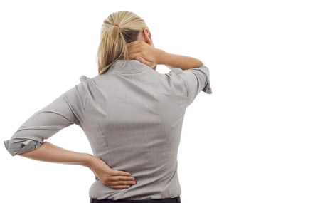 holding back: Woman with back pain isolated over a white background
