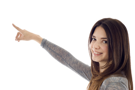 pointing finger up: Portrait of young business woman pointing at corner - Copyspace Stock Photo