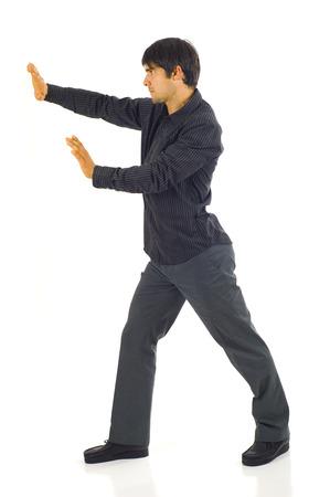 lookalike: Business man pushing something imaginary isolated on white Stock Photo