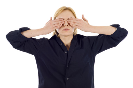 Woman covering her eyes - see no evil against white background