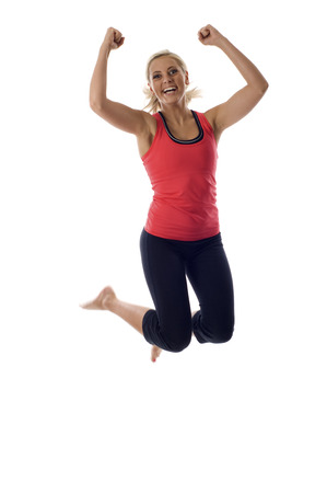 Excited young woman jumping isolated over a white background Stock Photo