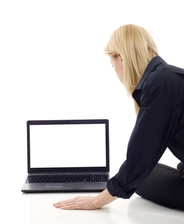 screen: Business woman from the back - looking at the laptop screen over a white background Stock Photo
