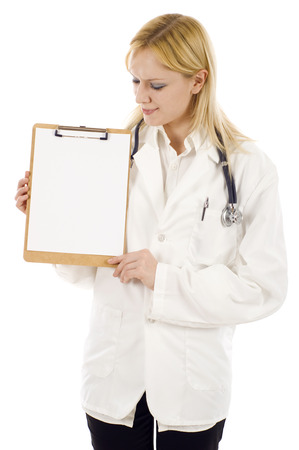 Doctor looking at the medical clipboard isolated on white photo