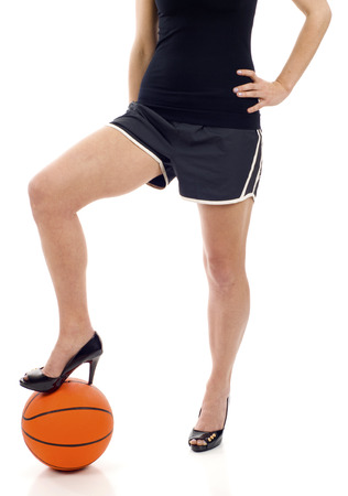 bodyscape: Beautiful legs on high heels with basketball isolated on a white background Stock Photo