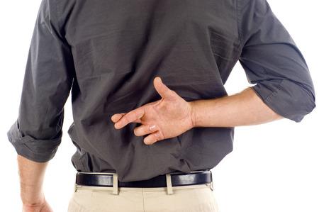 fingers crossed: Businessmanwith crossed fingers behind his back