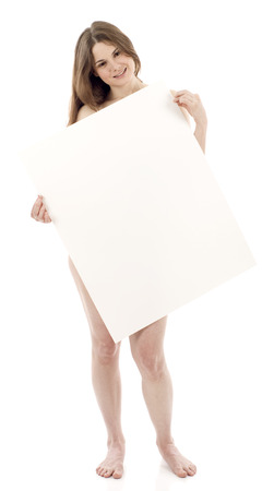 Full length of a beautiful naked woman holdng a blank sign isolated over white. Banque d'images