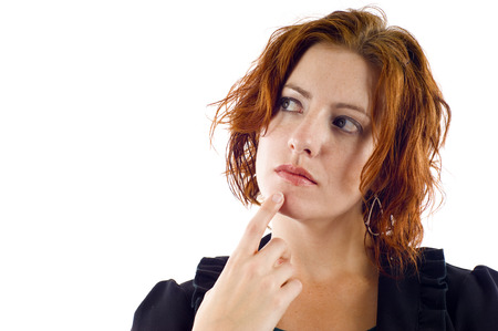 Beautiful red hair pensive woman isolated over white